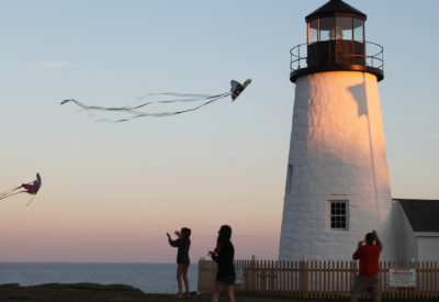 Pemaquid Point Lighthouse during sunset with kit fliers.